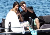 Snap happy: The pair had fun looked at some of the pictures they had taken of their PDA-filled day