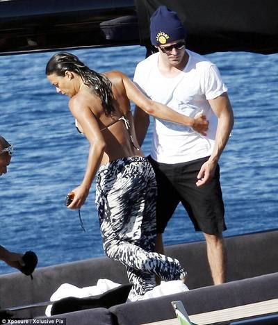 Touching: Michelle also had a grab of Zac's muscly chest as she walked past him on the boat
